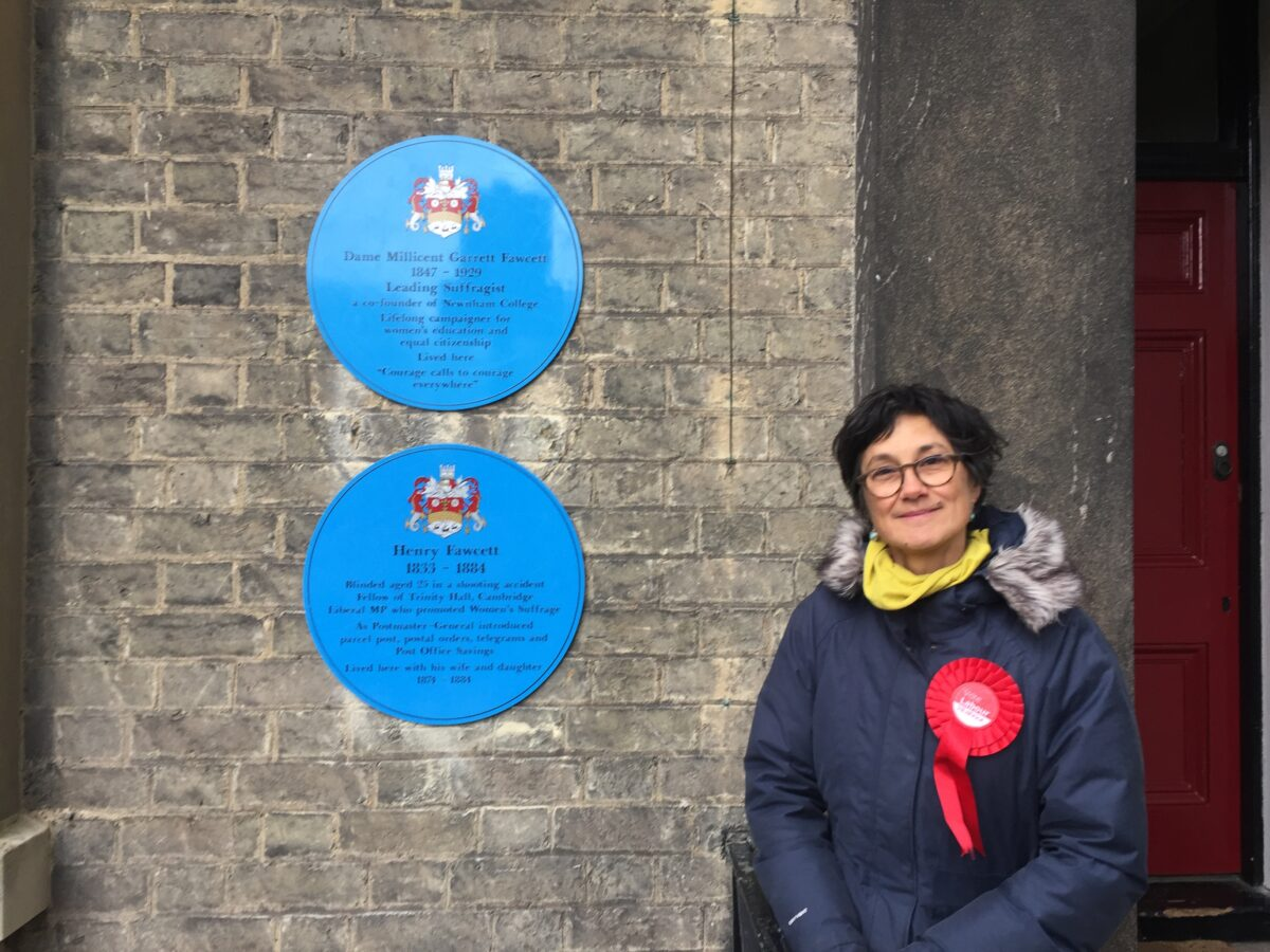 Katie next to plaque to Millicent Fawcett