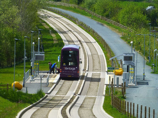 Kerb-guided track and adjacent multi-user path along a disused rail line, on the Leigh-Salford-Manchester Bus Rapid Transit, photo from wikicommons
